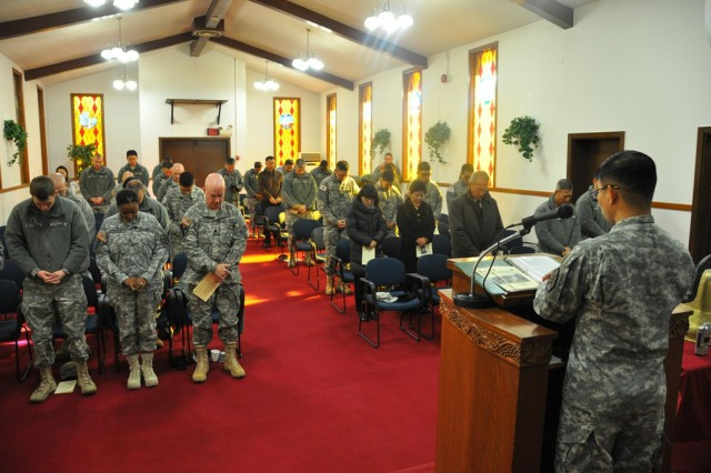Attendees of the Religious Retreat Center decommissioning ceremony bow their heads in prayer, Nov. 21. The functions and community services of the RRC have relocated to the South Post Chapel on U.S. Army Garrison Yongsan, to continue serving the community members as it has for the past 58 years. The land previously occupying the RRC is being returned to the Korean government as part of the Area II transformation plan. (U.S. Army photo by Cpl. Jung Jihoon)