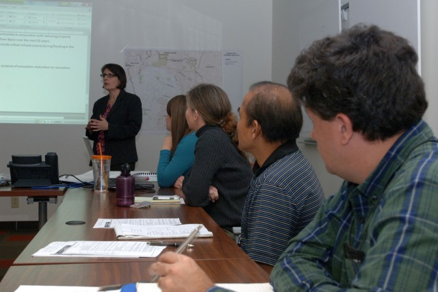 Nancy Parrish, a planner with the U.S. Army Corps of Engineers Fort Worth District, facilitates a planning charrette at the Nashville District Nov. 20, 2013 designed to conduct the Harpeth River Flood Risk Management Feasibility Study in a way that is specific, measurable, attainable, risk informed and timely. (USACE photo by Leon Roberts)