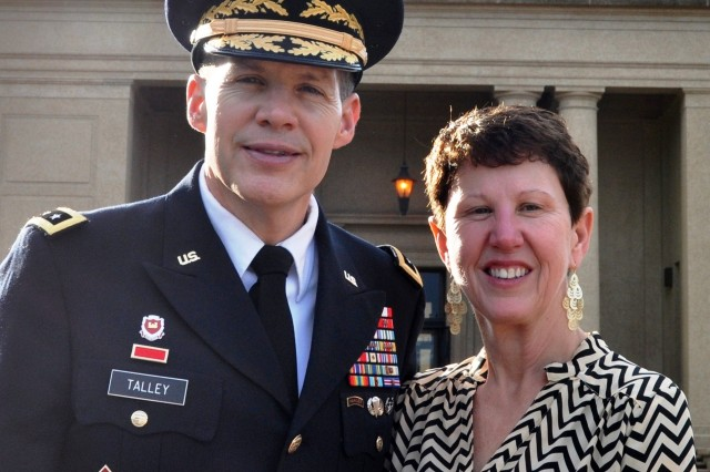 Lt. Gen. Jeffrey Talley and his wife Linda pause for a photo at the base of the Bell Tower at Lousiana State University, Nov. 22, 2013. The Talley's are both alumni of the university where the general earned his commission through the Reserve Officer Training Corps program and has since risen to the position of chief of Army Reserve and commanding general of U.S. Army Reserve Command. The Talley's were back on campus to support LSU Salutes, a weekend of activities honoring military veterans.