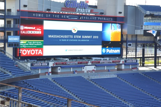 A graphic of the 2013 Massachusetts STEM Summit is displayed at Gillette Stadium in Foxborough, MA.