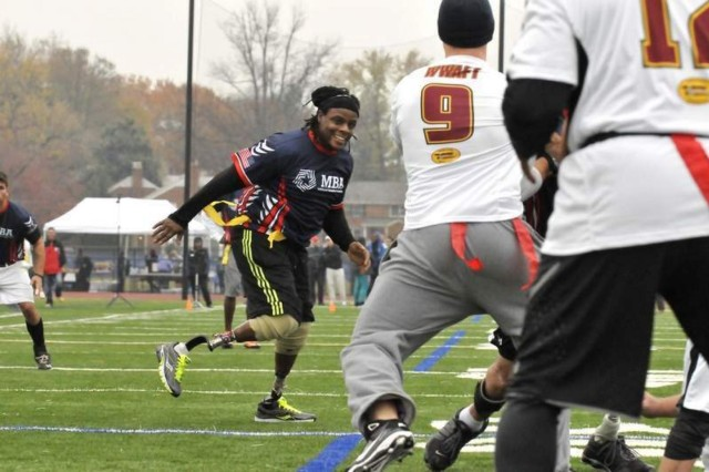 Wounded Warrior double-amputee, U.S. Army veteran and defensive lineman Alan Lewis rushes through a line of blockers in the second half of the Wounded Warrior Amputee Football Team - NFL Alumni flag football game in Arlington Nov. 16.