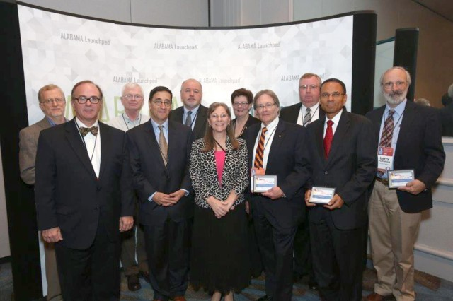 The 2013 Economic Development Partnership of Alabama statewide patent award recipients include, from left, in the front row:  Steve Cornelius, The U. S. Army Aviation and Missile Research Development and Engineering Center, or AMRDEC; Art Tipton, patent presenter from Southern Research Institute; Cindy Wallace, AMRDEC; John Weete, Auburn University Research and Technology Foundation; and Glyn Agnew, AT&T. In the back row are Kevin Schneider, ADTRAN; James McGroary, NASA; Dave Winwood, University of Alabama at Birmingham Research Foundation; Susan McRae, U.S. Army Space and Missile Defense Command/Army Forces Strategic Command; and Mark Roberts  and Larry Fullerton, Correlated Magnetics Research.