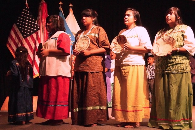 The Tohono O' odham Traditional Singers and Dancers Group shares some of their traditional songs at the Native American Heritage Month observance Friday at Fitch Auditorium, Alvarado Hall. While the singers perform in the background, the dancers demonstrate a basket dance.