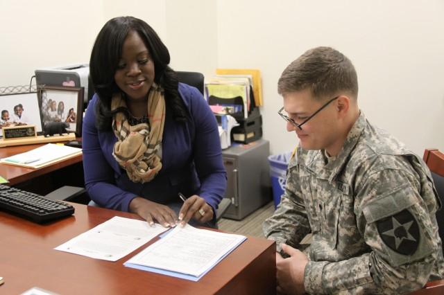Spc. Mason Steill gets financial assistance on Oct. 25 from Frederica Norman, a financial advisor at the Soldier and Family Assistance Center at Joint Base Lewis-McChord, Wash. Soldiers can get individualized financial assistance and can attend finance classes at the SFAC.