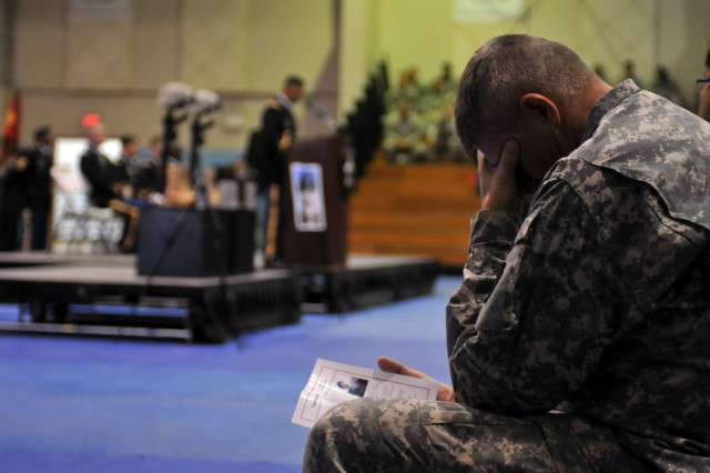 A 2nd Infantry Division Soldier mourns the loss of his fallen comrades during a Nov. 26 memorial ceremony at Camp Casey, South Korea. (Photo by Mr. Chin U. Pak, 2ID Public Affairs Office)
