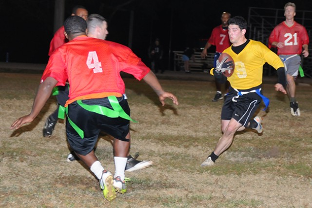 Second Lt. Brennan Rendel, captain and quarterback for Waiver Wire, runs the ball during an intramural football game at the Fort Rucker Physical Fitness Center football field Nov. 21. Waiver Wire beat the Old Warriors 20-6.