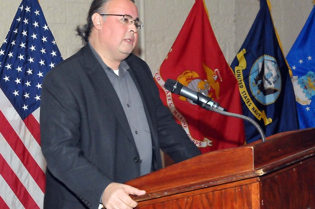 "Dr. Scott Manning Stevens, a member of the Iroquois Akwesasne Mohawk Nation, addresses members of the Rock Island Arsenal, Ill., community during this year's ""National American Indian Heritage Month"" observance Nov. 26. This year's theme is ""Guiding Our Destiny with Heritage and Traditions."" (Photo by Jon Micheal Connor, ASC Public Affairs)"