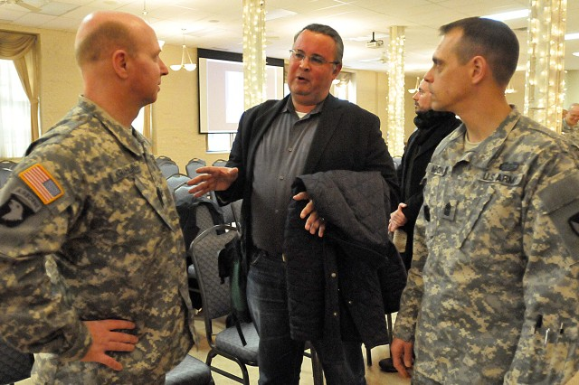 "Dr. Scott Manning Stevens talks with Col. William Krahling (left), commander, Distribution Management Center, Army Sustainment Command, and Sgt. Maj. Brian Marone, DMC, ASC, after serving as the guest speaker at Rock Island Arsenal's ""National American Indian Heritage Month"" observance Nov. 26. (Photo by Jon Micheal Connor, ASC Public Affairs)"