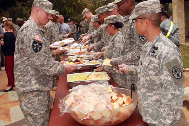 FORT SAM HOUSTON, Texas - Commanders and first sergeants from the Warrior Transition Battalion, along with senior leaders from various commands at Fort Sam Houston, serve a Thanksgiving meal to wounded warriors and their families Nov. 20 in the courtyard of the Warrior and Family Support Center. The annual event was hosted by the WTB and WFSC. Maj. Joshua Daily, executive officer for the WTB, said more than 460 people were served. The thanksgiving meal this year was turkey, ham, sweet potatoes, cranberry sauce and pumpkin and pecan pie.
