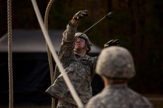 """U.S. Army Sgt. Robert D. Keifer, assigned to Honor Guard Company, 4th Battalion, 3rd Infantry Regiment (The Old Guard), Fort Myer, Va., representing the National Capital Region participates in the leadership reaction course as a part of the 2013 Army Best Warrior Competition at Fort Lee, Va., Nov. 21, 2013. Keifer is one of 24 competitors striving to earn the title of """"Best Warrior."""" (U.S. Army photo by Spc. Steven Hitchcock/Released)"""