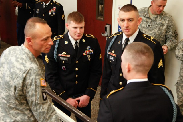 Command Sgt. Maj. James Bodecker meets with soldiers representing his command group before board proceedings of the 2013 Army Best Warrior Competition at Fort Lee, Va., Nov. 22, 2013. The board is the final event of the nearly weeklong competition used to determine the Army's best soldier and noncommissioned officer. (U.S. Army photo by Sgt. Stephen J. Schmitz/Released)