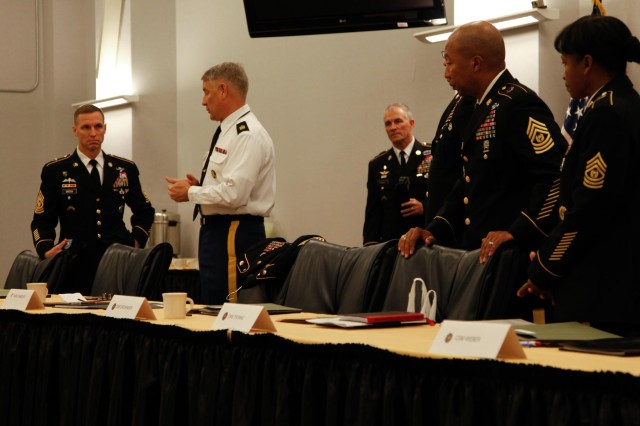 Sgt. Maj. of the Army Ray Chandler meets with the other board members before board proceedings of the 2013 Army Best Warrior Competition begin at Fort Lee, Va., Nov. 22, 2013. The board is the final event of the nearly weeklong competition used to determine the Army's best soldier and noncommissioned officer. (U.S. Army photo by Sgt. Stephen J. Schmitz/Released)
