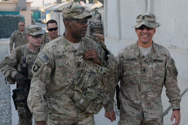 "NANGARHAR PROVINCE, Afghanistan "" U.S. Command Sgt. Maj. Alonzo Smith (left), senior enlisted leader, 101st Airborne Division, greets Command Sgt. Maj. Noe Salinas (right), senior enlisted leader, 4th Brigade Combat Team, 10th Mountain Division, at Forward Operating Base Fenty Nov. 28, 2013, as both of them travel across Regional Command-East, wishing the Soldiers a Happy Thanksgiving. Both men spent the holiday showing their Soldiers that, on this day of reflection, their troops are one of the things they are most thankful for. (U.S. Army Photo by Sgt. Eric Provost, Task Force Patriot PAO)"