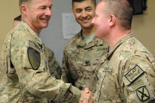 "NANGARHAR PROVINCE, Afghanistan "" U.S. Army Maj. Gen. James McConville (left), commander, 101st Airborne Division, presents his division's coin on Thanksgiving, Nov. 28, 2013, to Lt. Col. Alan Boyer (right), commander, 2nd Battalion, 30th Infantry Regiment, at Forward Operating Base Fenty, in appreciation for his hard work across a career full of deployments. McConville spent his holiday travelling Regional Command-East wishing Soldiers a Happy Thanksgiving and awarding coins to many whose dedicated service has carried them through multiple combat tours with the Army. 2nd Battalion is part of 4th Brigade Combat Team, 10th Mountain Division. (U.S. Army Photo by Sgt. Eric Provost, Task Force Patriot PAO)"