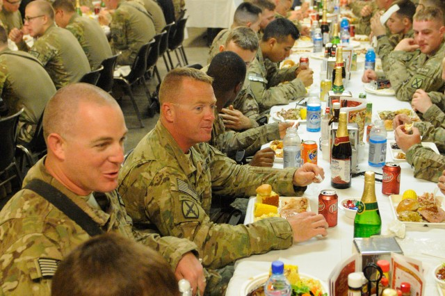 "NANGARHAR PROVINCE, Afghanistan "" U.S. Soldiers stationed in Afghanistan at Forward Operating Base Torkham celebrate Thanksgiving Day, Nov. 28, 2013, by enjoying a hearty meal and the company of friends. Even in a combat zone, time is set aside to recognize the holidays and embrace the enduring traditions that helped lay the groundwork for our entire way of life. (U.S. Army Photo by Sgt. Eric Provost, Task Force Patriot PAO)"
