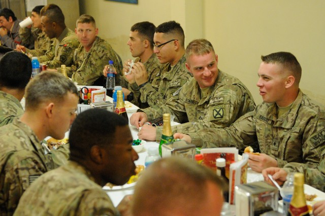 "NANGARHAR PROVINCE, Afghanistan "" U.S. Soldiers at Forward Operating Base Torkham take time to enjoy their Thanksgiving Nov. 28, 2013, by enjoying each others company along with the meal served to them by their commanders, as per Army Tradition. For many, the holiday serves not just as a time to celebrate but also to reflect on what they're thankful for and what they're fighting for. (U.S. Army Photo by Sgt. Eric Provost, Task Force Patriot PAO)"