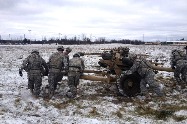 A team participating in Allons Avalanche performs one of three howitzer spins as part of the fourth physical challenge. The event required each team to march 6.2 miles and complete five different challenges along the route.