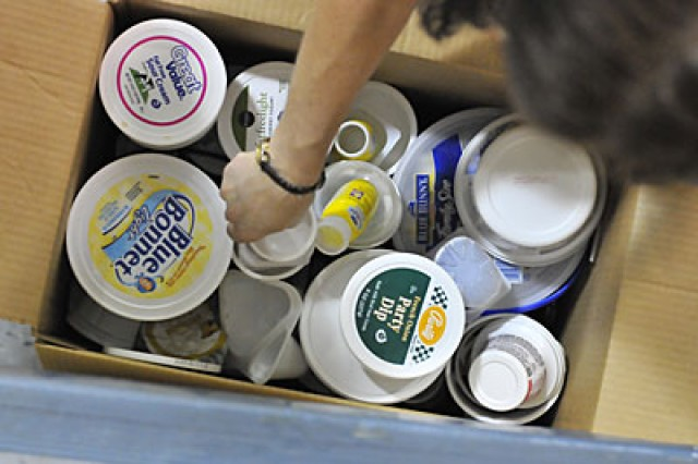 Plastic butter tubs and dip containers are among several items collected.
