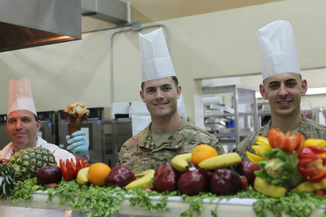 "LAGHMAN PROVINCE, Afghanistan "" U.S. Army Capts. Kyle Greer (middle) and David Wilson (right) stand on the serving line at Forward Operating Base Gamberi's dining facility preparing to serve the Soldiers on Thanksgiving Day, Nov. 28, 2013. It's a long standing tradition in the Army for leaders to serve the Soldiers for Thanksgiving as a way to give back to the troops for all of their hard work. (U.S. Army Photo by Spc. Edward Bates, 982nd Combat Camera Company (Airborne))"