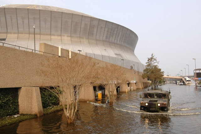 Hallock received an unexpected lesson in contingency contracting in 2005, right after Hurricane Katrina hit New Orleans, LA, during his four-month developmental assignment at Headquarters, U.S. Army Corps of Engineers as the deputy to the contracting director and acting PARC. Here, a National Guard High-Mobility Multipurpose Wheeled Vehicle leaves the Superdome Sept. 5, 2005, to patrol the streets after Katrina devastated the city and left thousands stranded.