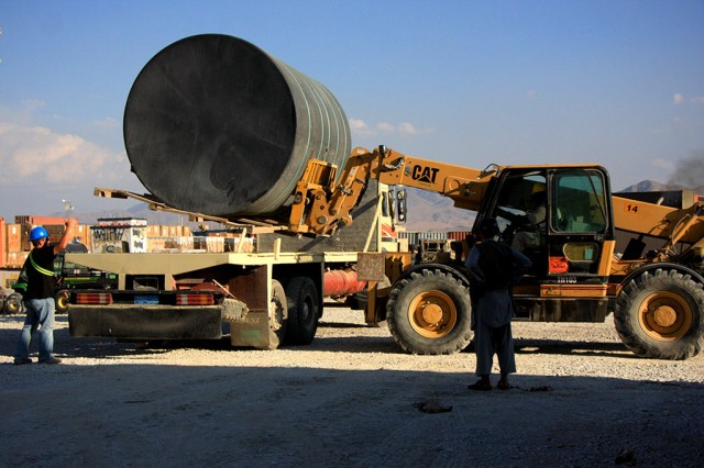 Contractors play an integral role in the retrograde of equipment from Afghanistan. Here, contractors from the Bagram Airfield Retrosort Yard load a water tank onto a contractedtransportation truck Nov. 2, 2012.