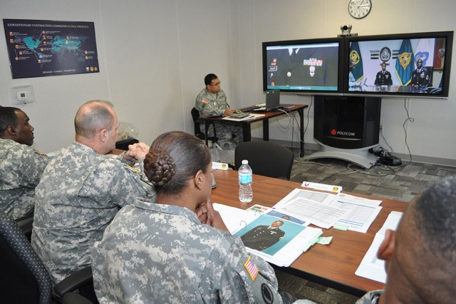 One of the greatest responsibilities of Army contracting leadership is to identify and encourage the next generation of managers, watchdogs, contracting officers and leaders. Here, ACC Command Sgt. Maj. John Murray, center left, and Command Sgt. Maj. Angel C. Clark-Davis, U.S. Army Expeditionary Contracting Command, conduct the NCO of the Year board by video teleconference.