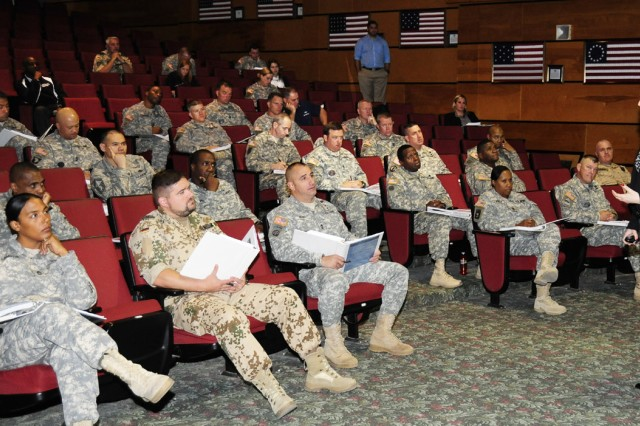 Students gather in the Sergeant Major Academy's Cooper Lecture Center on Day 1 of the Master Resilience Trainer course, at Biggs Army Airfield on Fort Bliss, Texas. Class 64 of the Sergeants Major Course is the first class that will graduate from the academy with the MRT additional skill identifier of 8R.
