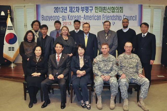 Members of the Bupyeong-gu Korean American Friendship Council pose for a group photo during a meeting, Nov. 27. The Bupyeong-gu KAFC works together to strengthen the ROK-U.S. alliance within the Area II military community. (U.S. Army photo by Cpl. Jung Jihoon)