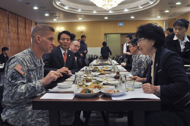 Col. Michael. E. Masley, garrison commander of U.S. Army Garrison Yongsan, left, and Hong Miyoung, mayor of Bupyeong-gu, share a conversation during the Bupyeong-gu Korean American Friendship Council meeting, Nov. 27. The Bupyeong-gu KAFC works together to strengthen the ROK-U.S. alliance within the Area II military community. (U.S. Army photo by Cpl. Jung Jihoon)