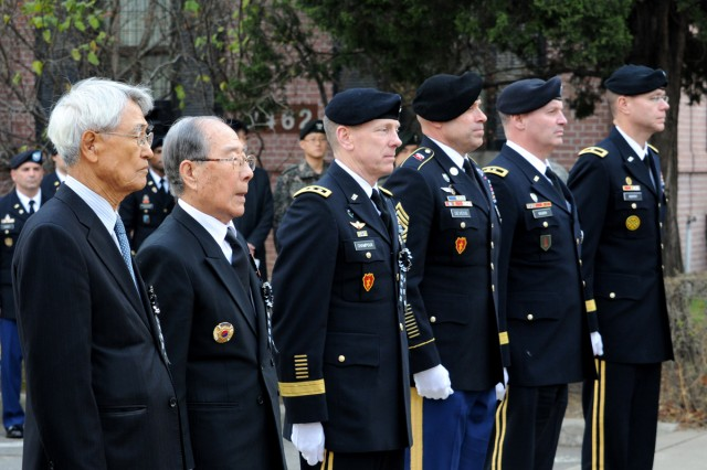 Korean War veterans and Eighth Army leaders pay respects to former Eighth Army Commander Gen. Walton H. Walker at a ceremony on Yongsan Garrison in Seoul, South Korea, Dec. 3, 2013.