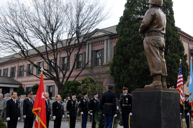Korean War veterans and Eighth Army leaders pay respects to former Eighth Army Commander Gen. Walton H. Walker at a ceremony at the Walker Statue on Yongsan Garrison in Seoul, South Korea, Dec. 3, 2013.
