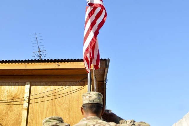 FORWARD OPERATING BASE ZANGABAD, Afghanistan -- Troopers with 1st Squadron, Combined Task Force Dragoon, render a salute during the lowering of the American Flag Nov. 27, 2013, at Forward Operating Base Zangabad, Afghanistan. The Troopers held a formal ceremony to commemorate the Afghan National Army assumption of responsibility for the FOB.