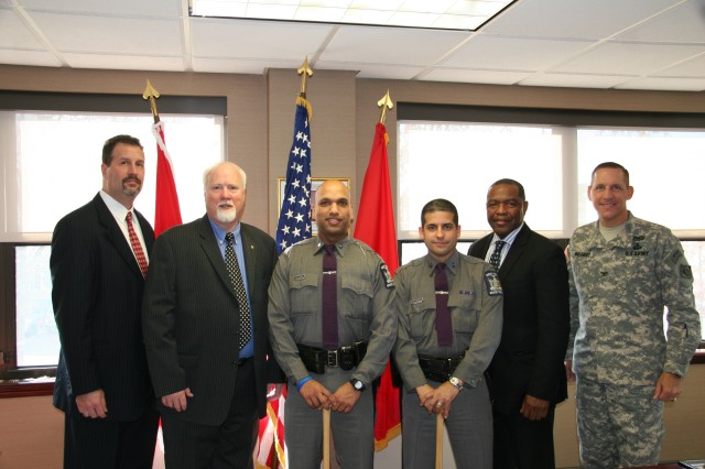 Troopers Vasquez and Herrera were recognized for the superlative support they directly provided to the U.S. Army Corps of Engineers, North Atlantic Division during recovery/response operations to Super Storm (Hurricane) Sandy. Here, they are standing with some of the individuals they supported.