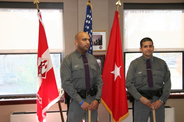"Troopers Vasquez and Herrera were recognized for the superlative support they directly provided to the U.S. Army Corps of Engineers, North Atlantic Division during recovery/response operations to Super Storm (Hurricane) Sandy. Here, they are holding the baseball bats they received as a token of how they were a big ""hit"" with those they supported. The bats, donated by Dinger Bat Company, were laser-engraved with the U.S. Army Corps of Engineers logo, the New York State Police emblem, the recipient's name and ""Hurricane Sandy Recovery/Response Operations, October - November 2012."""
