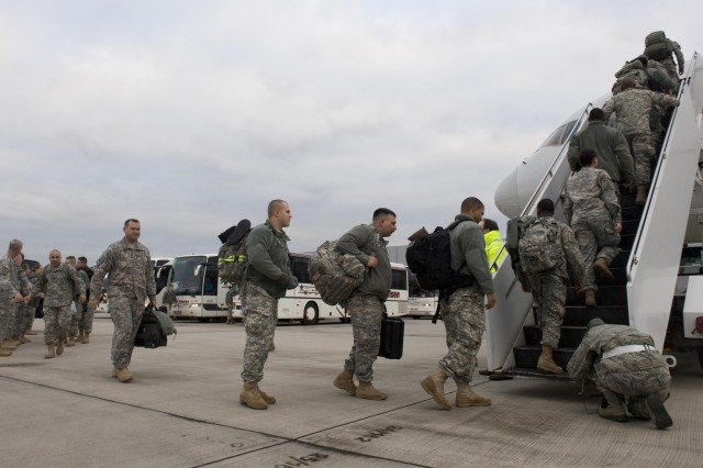 Soldiers from 5th Battalion, 7th Air Defense Artillery Regiment, 10th Army Air and Missile Defense Command, prepare to board a plane for deployment to Turkey in support of a NATO mission to augment Turkish air defenses. Two Patriot missile batteries from the 5-7th are replacing members of the 3rd Battalion, 2nd ADA from Fort Sill, Okla., who has been fulfilling the U.S. commitment to the mission in the Turkish city of Gaziantep since last December. Patriot batteries from Germany and the Netherlands are taking part in the mission as well from bases at other sites in Turkey.