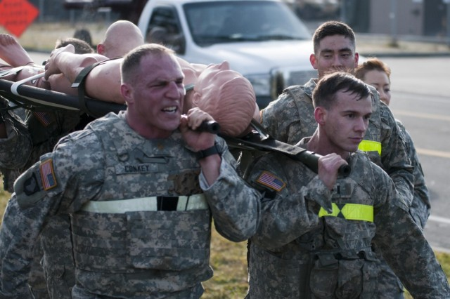 Soldiers with the 2nd Battalion, 1st Infantry Regiment perform a 1.5-mile litter carry with a 200-pound mannequin during the Iron Legion competition on Joint Base Lewis-McChord, Wash., Nov. 26. The Iron Legion Competition was a grueling physical event that pitted each platoon in 2-1 Inf., 2-2 Stryker Brigade Combat Team, 7th Infantry Division against each other as they raced against the clock to finish an array of obstacles.