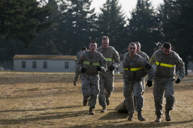 Soldiers with the 2nd Battalion, 1st Infantry Regiment, drag a SKED Medical Rescue System 400 meters during the Iron Legion competition on Joint Base Lewis-McChord, Wash., Nov. 26. The Iron Legion Competition was a grueling physical event that pitted each platoon in 2-1 Inf., 2-2 Stryker Brigade Combat Team, 7th Infantry Division against each other as they raced against the clock to finish an array of obstacles.
