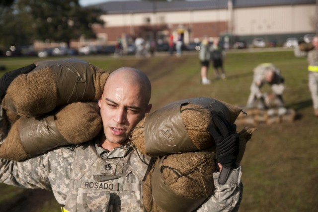 Staff Sgt. Jesus Rosado, a weapons squad leader with the 2nd Battalion, 1st Infantry Regiment, carries sandbags during the Iron Legion competition on Joint Base Lewis-McChord, Wash., Nov. 26. The Iron Legion Competition was a grueling physical event that pitted each platoon in 2-1 Inf., 2-2 Stryker Brigade Combat Team, 7th Infantry Division against each other as they raced against the clock to finish an array of obstacles.