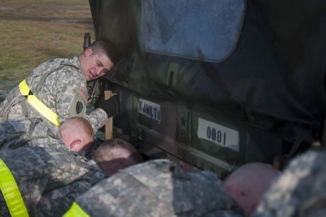 Soldiers with the 2nd Battalion, 1st Infantry Regiment push a M 792 High Mobility Multipurpose Wheeled Vehicle during the Iron Legion competition on Joint Base Lewis-McChord, Wash., Nov. 26. The Iron Legion Competition was a grueling physical event that pitted each platoon in 2-1 Inf., 2-2 Stryker Brigade Combat Team, 7th Infantry Division against each other as they raced against the clock to finish an array of obstacles.