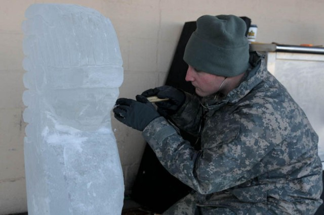 Spc. Patrick Laird, food service specialist, 296th Brigade Support Battalion, sculpts an Indian head sculpture out of clear ice for a local dining facility on Joint Base Lewis-McChord, Wash., Nov. 26, 2013. Soldiers participated in sculpting and culinary workshops to develop new skills in creating sculptures. (U.S. Army photo by Sgt. Christopher Prows, 5th Mobile Public Affairs Detachment / Released)