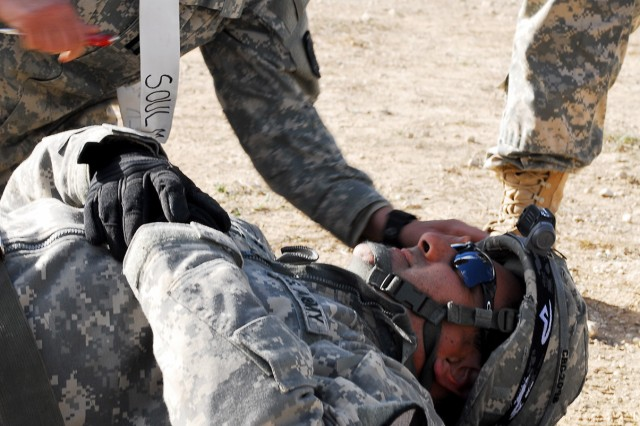 "A combat medic with Company C, 115th ""Muleskinner"" Brigade Support Battalion, 1st ""Ironhorse"" Brigade Combat Team, 1st Cavalry Division, treats a simulated casualty during a mass casualty exercise during Ironhorse Rampage, Nov. 14, at Fort Hood, Texas. During the exercise, Soldiers with simulated wounds were treated to test medics on properly treating simulated wounds. Soldiers of the Ironhorse Bde. participated in Ironhorse Rampage Nov. 4 to 22, conducting various training exercises in preparation for an upcoming rotation to the National Training Center."