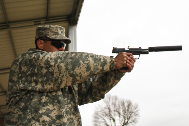"FORT CAMPBELL, Ky., - Sgt. Jesse Trevino, an infantryman assigned to Headquarters, Headquarters Company, 3rd Brigade Combat Team ""Rakkasans,"" 101st Airborne Division (Air Assault), fires a pistol with an attached suppressor at the range during the privately owned weapons mentorship day at Fort Campbell, Ky., Nov. 27, 2013. This Mentorship day was the first of its kind to be held within the 3rd Brigade and was designed to promote gun safety. (U.S. Army Photo by Sgt. Brian Smith-Dutton 3BCT Public Affairs)"