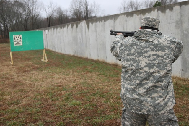 "FORT CAMPBELL, Ky., - Sgt. Jesse Trevino, an infantryman assigned to Headquarters, Headquarters Company, 3rd Brigade Combat Team ""Rakkasans,"" 101st Airborne Division (Air Assault), fires shotgun at the range during the privately owned weapons mentorship day at Fort Campbell, Ky., Nov. 27, 2013. This Mentorship day was the first of its kind to be held within the 3rd Brigade Combat Team and was designed to promote gun safety. (U.S. Army Photo by Sgt. Brian Smith-Dutton 3BCT Public Affairs)"