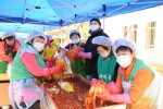 District volunteers help make kimchi for those in need
