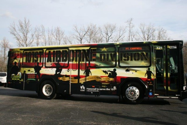 """The City of Clarksville unveiled its 101st """"Tribute Bus"""" Wednesday, Dec. 4, at the Clarksville Transit System Bus Fleet garage.  Clarksville Mayor Kim McMillan said the bus was a way of showing their support for the Soldiers and families of the 101st Airborne Division (Air Assault) and Fort Campbell."""