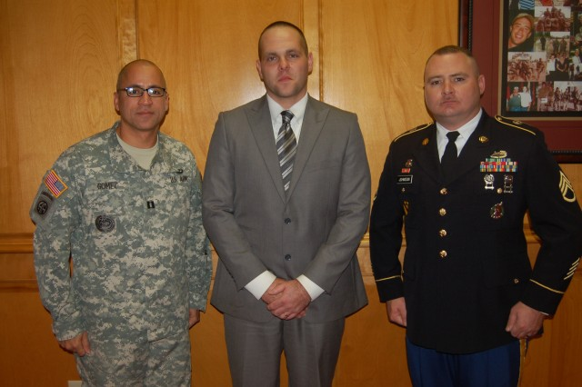 Pikeville attorney Justin C. Hamilton (center) is flanked by Capt. Ramon Gomez (left) and Army recruiter Staff Sgt. William Johnson.  Hamilton, 32, joined the Army Reserve 10 years after leaving active duty with the U.S. Marine Corps.