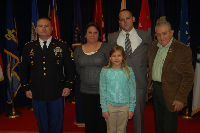Staff Sgt. William Johnson, commander of the Pikeville, Ky., Center, (left) poses with the family of Justin C. Hamilton shortly after the Pikeville attorney was sworn into the Army Reserve.  Also shown are: (left to right) Michelle Hamilton, Courtney Hamilton, Justin Hamilton and his grandfather, Claudie D. Little.