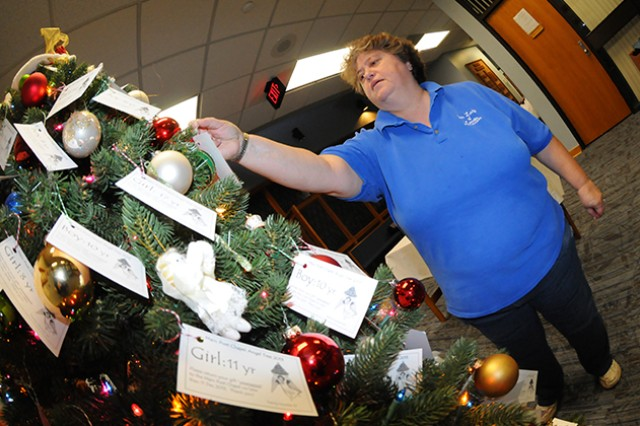 Nancy Jankoski, church community member, takes two tags from the Angel Tree located in the vestibule of the Main Post Chapel Nov. 26. Community members are asked to take a tag, purchase a gift, and return both gift and tag to the tree no later than Dec. 11.