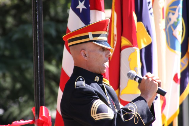 Master Sgt. Antonio Giuliano, U.S. Army Band vocalist, provides a stirring a cappella rendition of the Star Spangled Banner at the Old Post Chapel ribbon cutting ceremony.