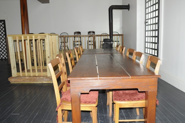 The military commission that tried and convicted the conspirators sat in front of the witness stand. The other conspirators sat along the back wall.